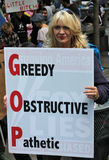 Greedy obstructive pathetic. Protester, Woman holding sign at occupy wall st. Greedy obstructive pathetic Fox Lies stock photos