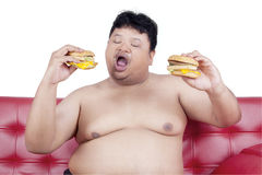 Greedy person enjoy two hamburger Royalty Free Stock Photography