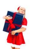Greedy Santa woman with big Christmas gift box Stock Photos