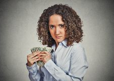 Greedy woman corporate business employee holding dollar banknotes tightly royalty free stock image