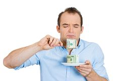 Greedy woman eating cash Royalty Free Stock Photography