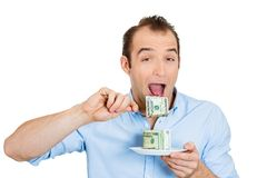 Greedy woman eating cash Royalty Free Stock Image