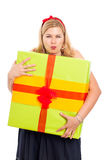 Greedy woman with gift Stock Photo