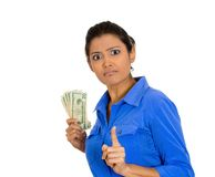 Greedy woman holding cash. Closeup portrait of greedy young woman corporate business employee, worker, student holding dollar banknotes tightly, isolated on Royalty Free Stock Photos