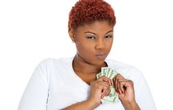 Greedy woman holding cash Stock Photo