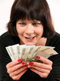 Greedy woman holding money. Portrait of a greedy woman holding money Royalty Free Stock Photos