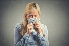 Greedy young woman, holding tight dollar banknotes Stock Image