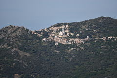 Greeen Corsican mountain with a town Lavatoggio Stock Photo