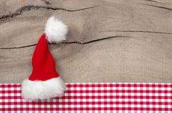 Greeeting card with santa hat for chrismas card or coupon Royalty Free Stock Photography