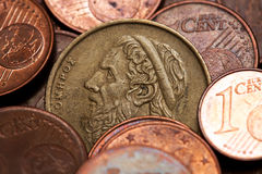 Greek 50 drachmas coin among euro coins. Old greek coin among euro coins, drachmas (with the face of Hommer, the ancient Greek  poet Royalty Free Stock Photography