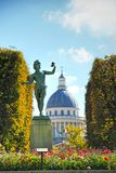 Luxembourg Garden in Paris, France. A Greek actor an ancient statue, against the background of the Pantheon in the Luxembourg Garden Paris. France royalty free stock image