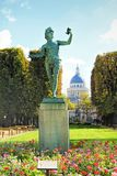 Luxembourg Garden in Paris, France. A Greek actor an ancient statue, against the background of the Pantheon in the Luxembourg Garden Paris. France royalty free stock photo