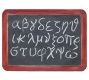 Greek alphabet on blackboard Stock Photos