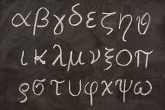 Greek alphabet on blackboard stock photography