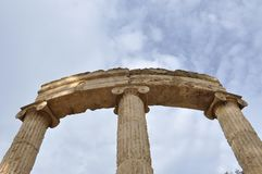 Greek ancient dorian columns in Olympia Greece. Greek ancient dorian columns guarding the entrance in Olympia Greece historical site Royalty Free Stock Photography
