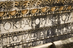 Greek ancient letters. Greek script ancient letters on a rock in Ephesus, Turkey Stock Images
