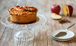 Greek apple pie on crystal cake plate Royalty Free Stock Image