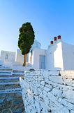 Greek architecture. Whitewashed buildings and an orthodox church with pastel blue painted doors, all typical features of Greek architecture Royalty Free Stock Images