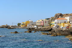 Greek architecture at rocky coastline of Paleochora town on Crete island, Greece Stock Images