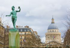 Greek Author (Bronze Author) and Pantheon in Paris, France. View on the Pantheon, a famous building in the Latin Quarter in Paris, France, and the royalty free stock photos