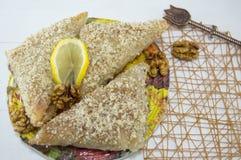 Greek baklava with lemon and Turkish coffee served Stock Photos