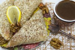 Greek baklava with lemon and Turkish coffee served Stock Image
