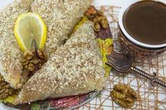 Greek baklava with lemon and Turkish coffee served Stock Image