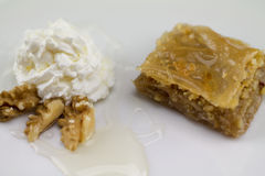 Greek baklava served with yogurt and walnuts Stock Images