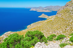 Greek bay with green bushes and blue sky, Greece Royalty Free Stock Photography