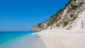 Greek beach. With empty next to a cliff Stock Images