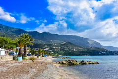 Greek beach on the island of Corfu in the mediterranean. Greek beach on the island of Corfu Kerkyra in the mediterranean sea with sunny weather stock image