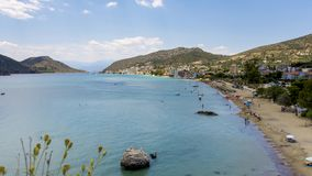 Greek beach with people swimming 4K timelapse. Tolo, Greece stock footage