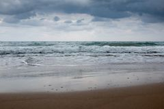 Greek beach with turquoise water in a cloudy day royalty free stock photography