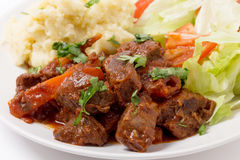 Greek beef in red sauce Royalty Free Stock Photo