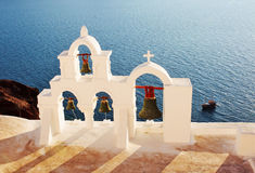 Greek bell tower in Santorini. Greece. Traditional Greek bell tower in the village of Oia. Santorini. Greece Stock Photo