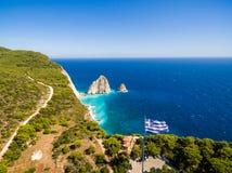 Greek biggest national flag waving in the sky in Keri in Zakynth. Os Zante island in Greece Royalty Free Stock Photos