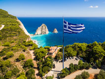 Greek biggest national flag waving in the sky in Keri in Zakynth Royalty Free Stock Photography