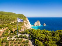 Greek biggest national flag waving in the sky in Keri in Zakynth. Os Zante island in Greece Royalty Free Stock Images