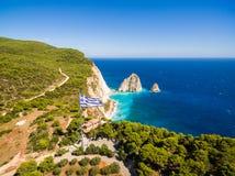 Greek biggest national flag waving in the sky in Keri in Zakynth. Os Zante island in Greece stock image