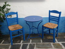 Greek bleu table and chair. Chairs and table, street coffee taverna bleu Royalty Free Stock Images