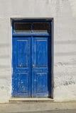 Greek blue door Stock Photography