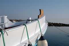 Greek boat. The bow of a typical greek fishing boat with the early morning sun shining on it Royalty Free Stock Images
