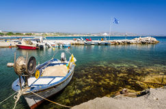 Greek boat harbor for small boats. Small fishing boat in tropical harbor Stock Photos