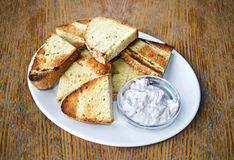 Greek bread with yoghurt sauce Stock Images