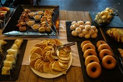 Greek breakfast buffet table full with varieties of pastries, buns, pancakes, donuts, butter cake, local sweets dishes, etc. Royalty Free Stock Photo