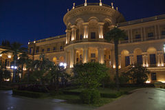 Greek building nightscene. Beautiful villa in ancient greek classic style with landscaped green territory; outdoor panorama with copy space royalty free stock image