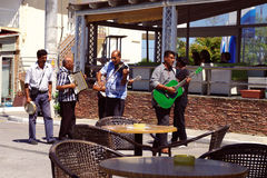 Greek buskers. At the sunny summer day outside, Porto Lagos Stock Photos