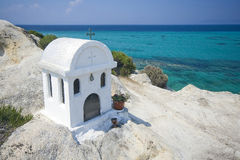 Greek chapel. A beautiful white chapel in a Greek village Sarti Royalty Free Stock Photos