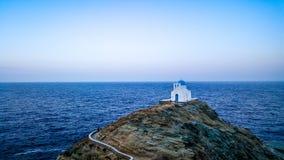 Greek chapel on an island Stock Photos