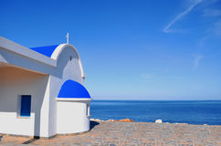 Greek chapel on the sea Royalty Free Stock Photography